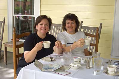 Allison and Melissa eat brunch on the veranda