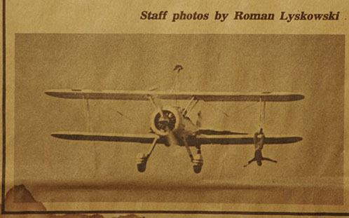 Ron wife Nour walks on the wings on a bi-plane