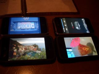 four iphones at dinner