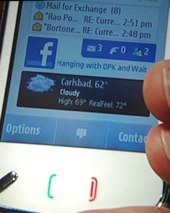 Nokia N97 showing widgets for weather, mail and Facebook