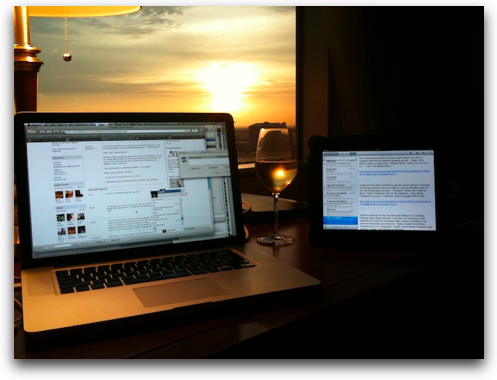 the Mac, the iPad, a glass of wine and a sunset