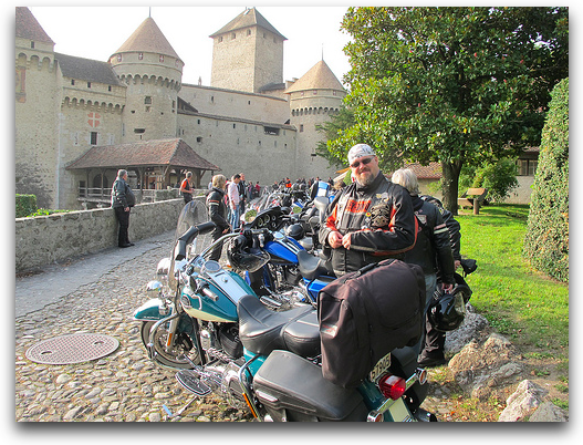 Paul sitting on his Harley right outside a gorgeous castle