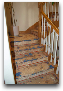 stairs with crud on floor, no carpet, glue being scraped off