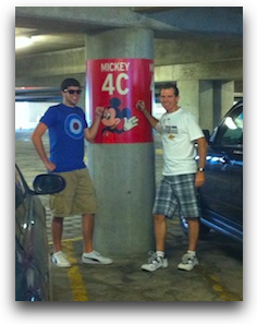 pic of steve and kyle standing next to sign that shows mickey mouse and 4C so we can remember where we parked at disneyland