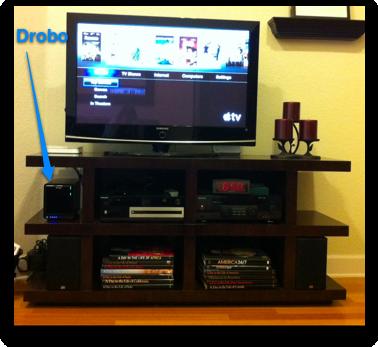 Katie's drobo next to her TV. nice blue lights!