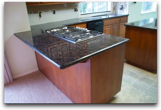 black/grey/brown granite, mahogany cabinets, staineless steel appliances