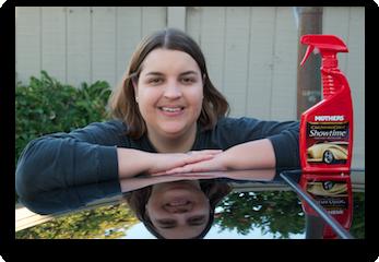 Katie waxing a car