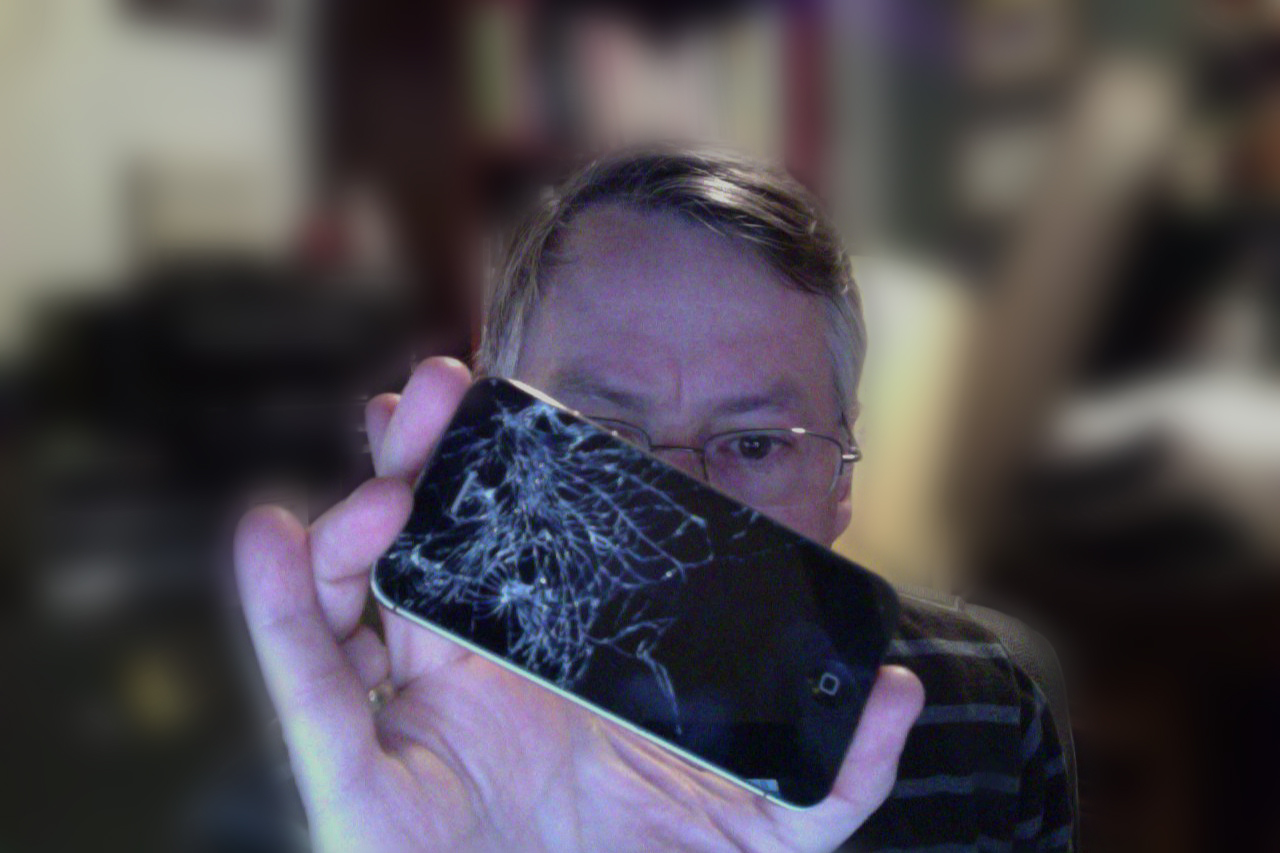 Mark holding up his sadly shattered iPhone