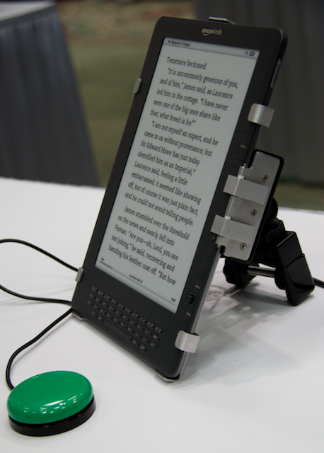 kindle with this giant clamp on the back and two plates pushing the buttons