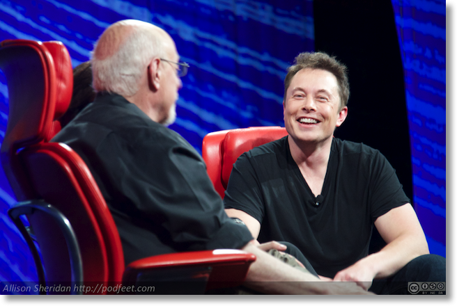 Elon Musk laughing during interview with Walt