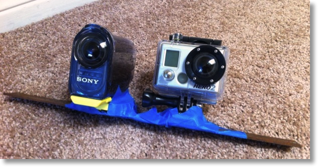 gopro and sony gaffer taped to a metal bar (looks very silly)