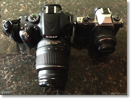 comparison shot of the two cameras (hint, the D5100 is HUGE)