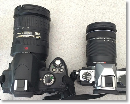 2 cameras showing their zoom lenses