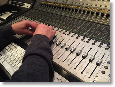 Slau hands on the mixing board