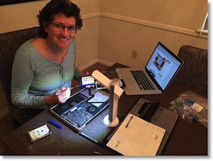 pic of me with the laptop torn open and my happy driver from iFixit