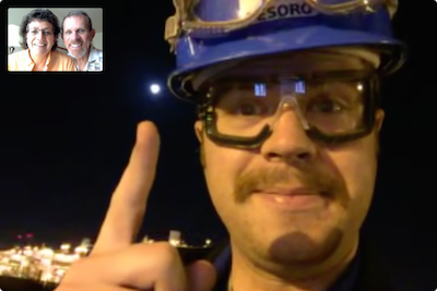 Kyle in hardhat pointing at the moon