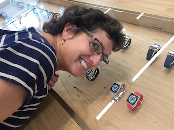 Allison grinning like an idiot with her face up against the Apple Watch Edition glass