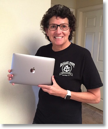 Allison proudly holding the 12_inch_macbook