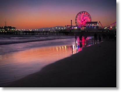 Santa Monica Pier with ferris wheel lit up in colors